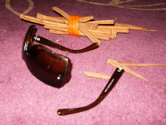 Sunglasses and cinnamon sticks